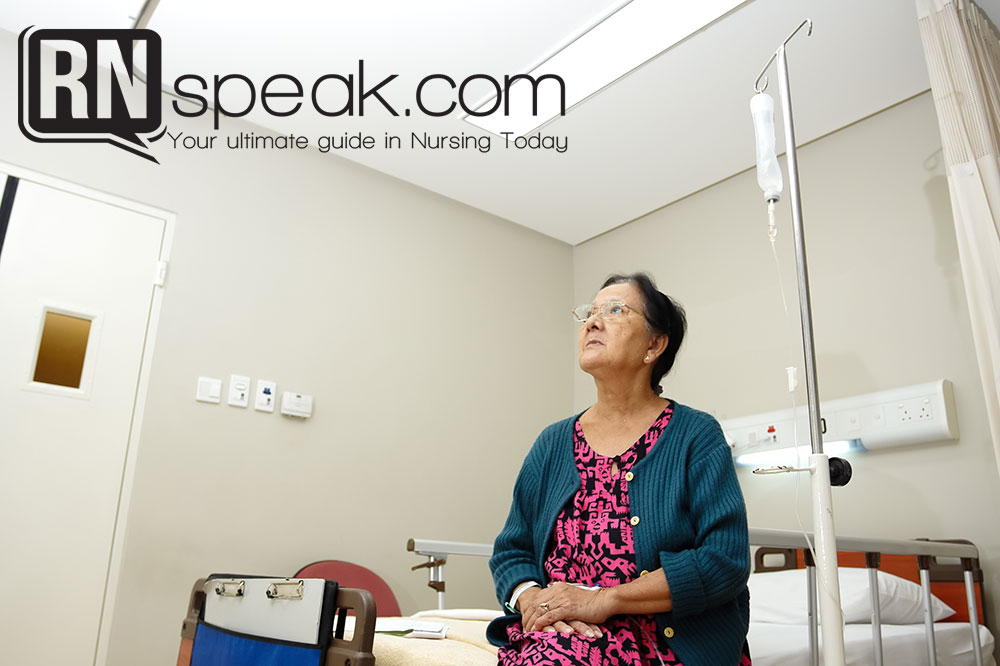 senior lady patient alone in hospital ward